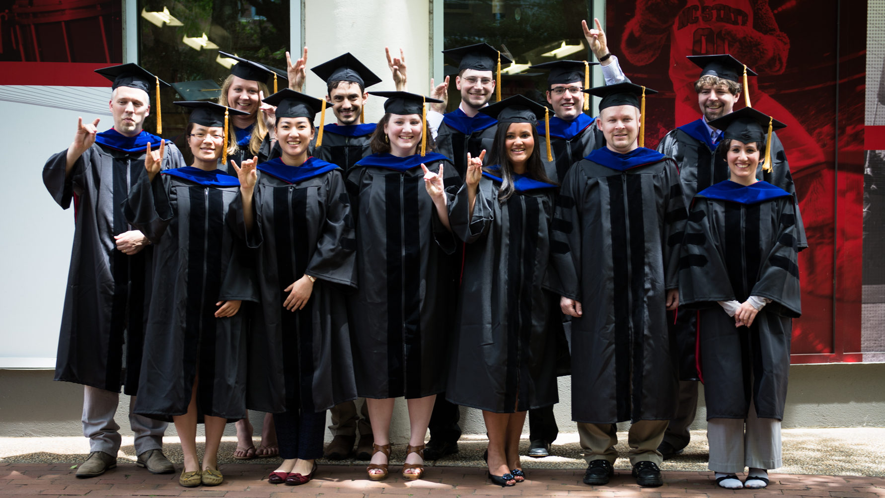 Students in black caps and gowns at graduation