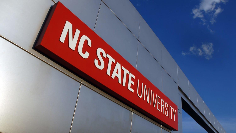 Campus gateway sign reading NC State University