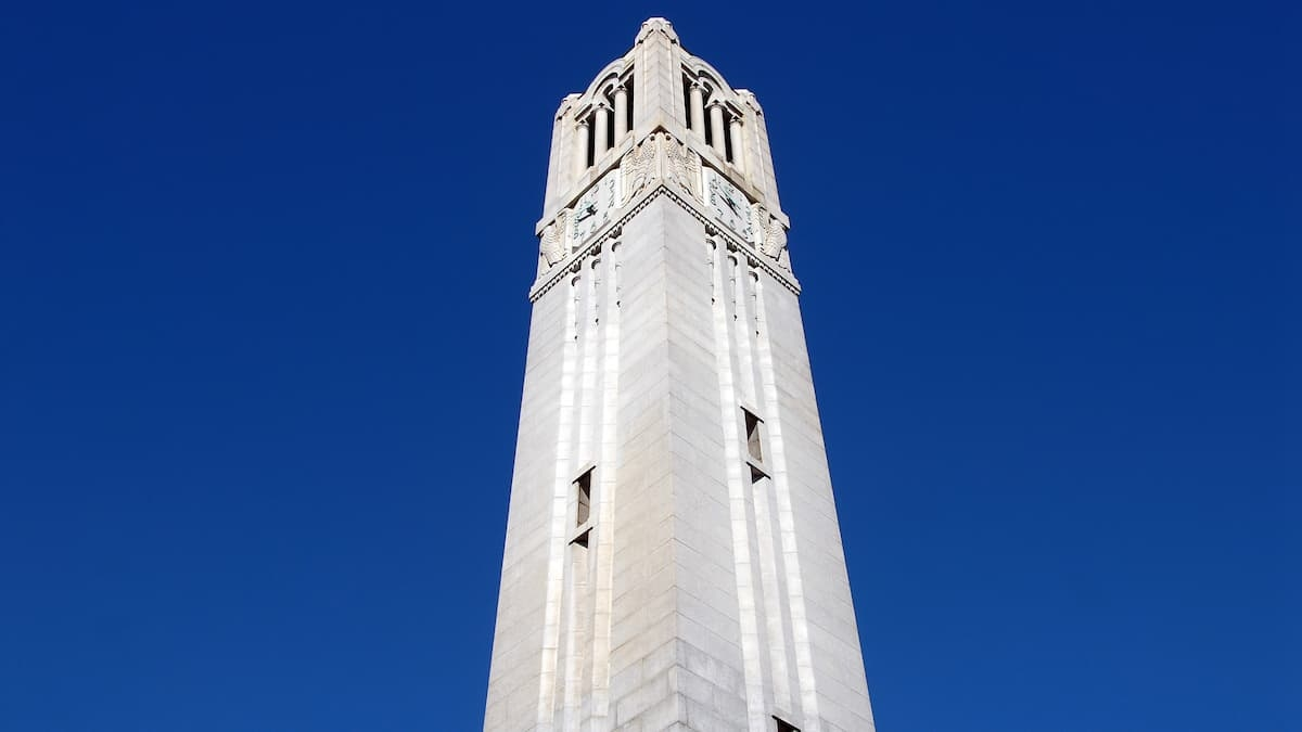 NC State Belltower under a crisp blue fall sky.