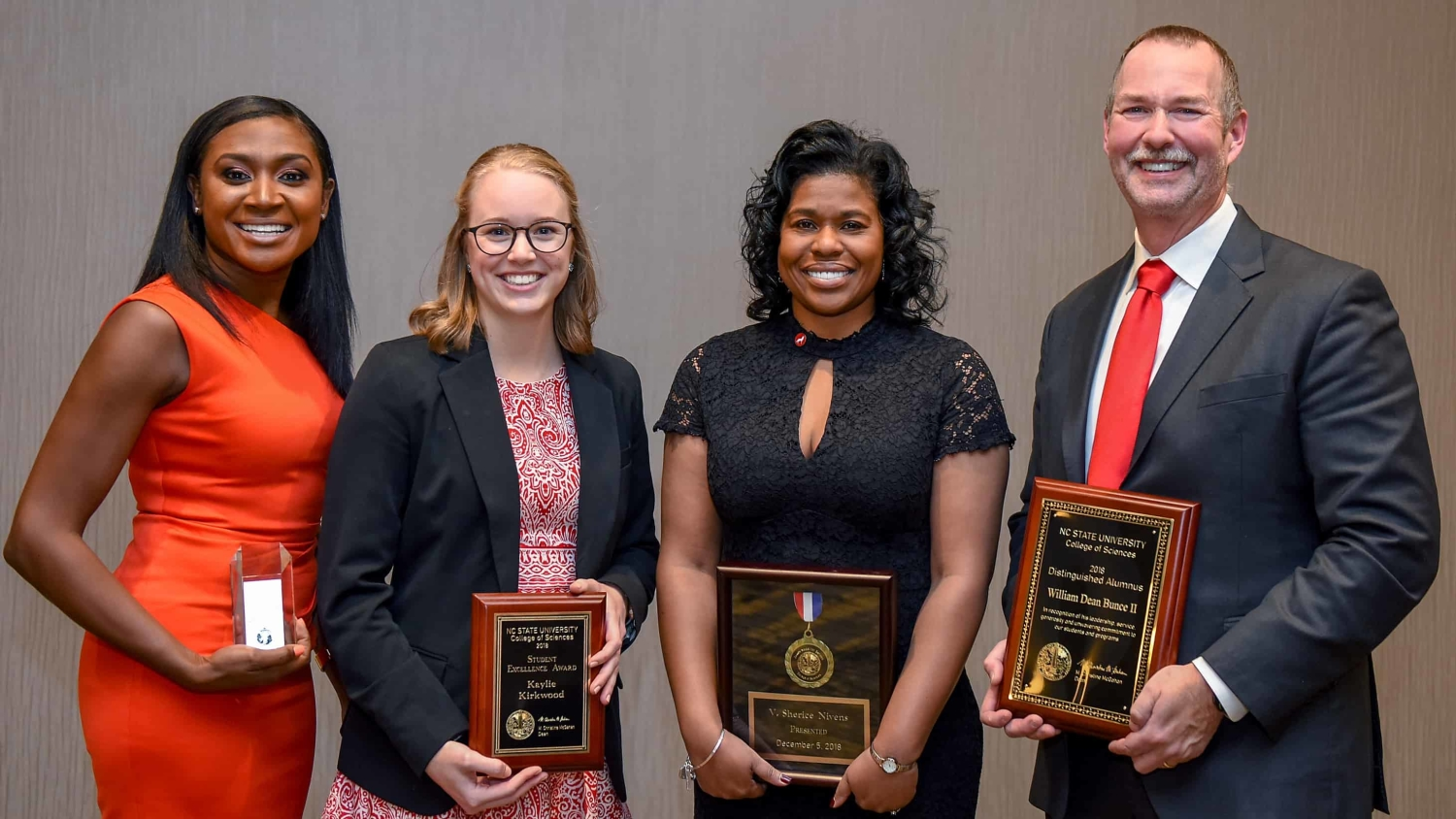 College of Sciences Award Winners pose with their awards.