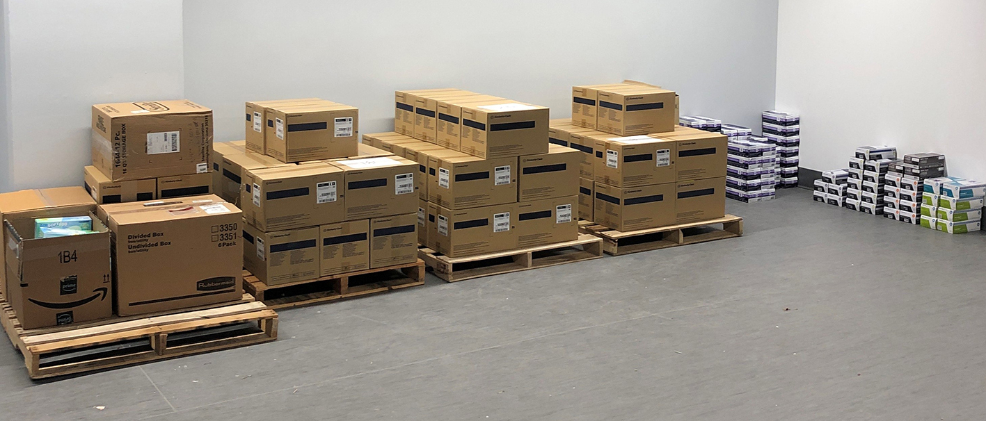 Stacks of PPE boxes intended for donation to local hospitals during COVID-19 outbreak