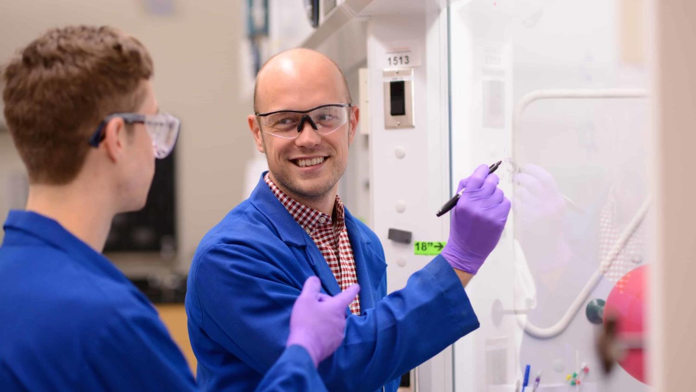 Joshua Pierce works in his lab
