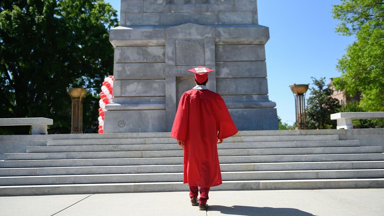 graduate at Memorial Belltower