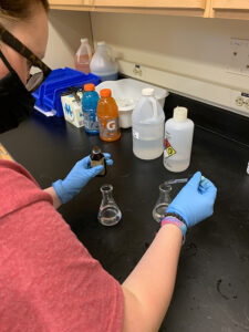 A student prepares a solution for the General Chemistry lab session.