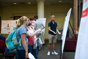 Current undergraduate researchers showcase their work during lunch at Labapalooza.
