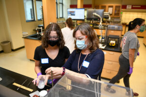 Students work one on one with faculty and graduate students in the Organic Chemistry lab session.