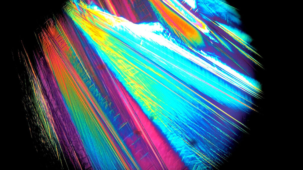 Envisioning Research Contest Winner Shelby Boyd: Microscopic Peacock Tail: Fanning Zinc Chloride Trihydrate Crystals